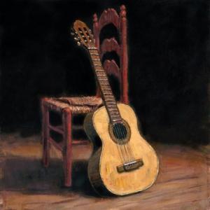 guitarra apoyada en la silla