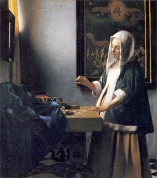 Vermeer - mujer sosteniendo una balanza (1664)